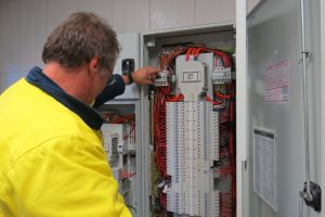 electrician-checking-mains-switchboard