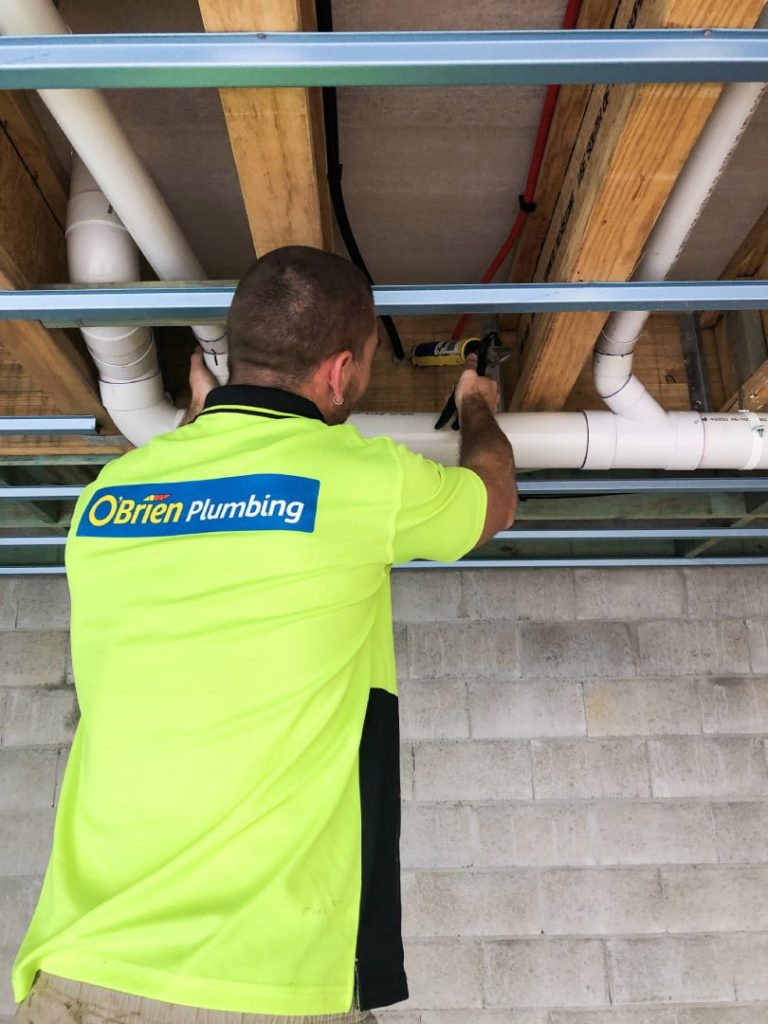 Plumber installing piping in Maroochydore, Sunshine Coast